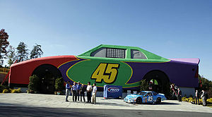 Adam Petty - President George W. Bush is joined at Adam's Race Shop on the grounds of Victory Junction Gang Camp, Inc., in Randleman, N.C., by Kyle and Richard Petty, Michael Waltrip and Jimmie Johnson.
