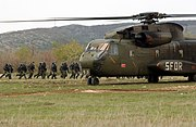 German CH-53 Helicopter assigned to the Stabilization Force and Portuguese Army Soldiers