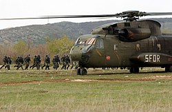 German CH-53 Helicopter assigned to the Stabilization Force and Portuguese Army Soldiers.jpg