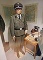German occupation of Norway during WW2 SD Gestapo SS-Hauptscharfuhrer uniform office Heereskarte maps dagger handcuffs spring steel baton club mannequin maps lamp etc Arquebus krigshistorisk museum 2020 No known copyright restrictions.jpg