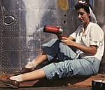 Girl worker at lunch also absorbing California sunshine, Douglas Aircraft Company, Long Beach, Calif. LOC 2179923542 (cropped).jpg