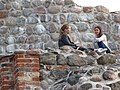 Girls with Castle Walls - Vilnius - Lithuania (27840745155).jpg