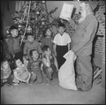 Granada Relocation Center, Amache, Colorado. In his Santa Claus mask, wearing a pair of red pajamas . . . - NARA - 539497.tif