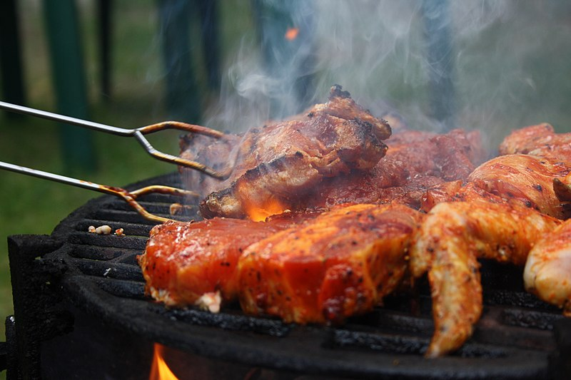 File:Grilled steaks turned by grill tongs near Hostákov, Vladislav, Třebíč District.jpg