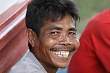 Grinning Laotian showing teeth.jpg