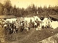 Group of Puget Sound Indians, possibly hop pickers, with tents and buildings in background, Washington, ca 1889 (BOYD+BRAAS 87).jpg