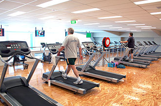 Health club - A cardio theatre including treadmills, stationary bikes and TV displays