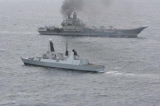 Standing Royal Navy deployments - Fleet Ready Escort HMS Dragon escorting the Russian aircraft carrier, Admiral Kuznetsov, through the English Channel