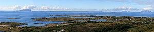 Strandflat - View of the strandflat at Helgeland fra mountain Dønnesfjellet i Dønna. A number of rauks are seen, from left: Træna, Lovunda, Selvær, Nesøya, Hestmona, Rødøyløva og Lurøyfjellet, all of them landmarks on the Norwegian Coast.  photo:Mahlum
