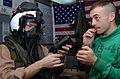 Helicopter Anti-submarine FOUR's (HS 4) Aviation Anit-submarine Warfare Operator Second Class (AW-NIC) Jarad Gilbertson of Cedar Ridges, I.W. recieves help from Survival Equipmentman Second Class Coale Lindsay 030323-N-AK921-030.jpg