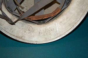 Stampings on a World War II civil defense helm...