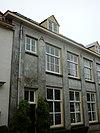 foto van Pand met verdieping en hoog schilddak
