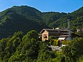 House with power line and mountains in Esino Lario.jpg