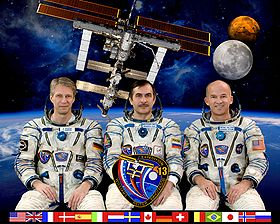 ISS expedition 13 crew with reiter.jpg