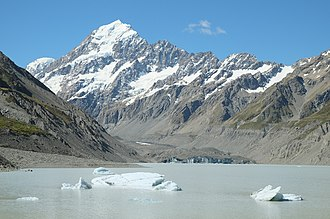 Hooker Glacier (New Zealand) - View across glacier lake to Hooker Glacier terminus in front of Aoraki / Mount Cook