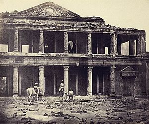 War photography - The ruins of Sikandar Bagh palace showing the skeletal remains of rebels in the foreground, Lucknow, India, 1858, by Felice Beato.