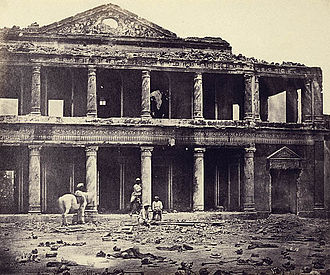 Felice Beato - The ruins of Sikandar Bagh palace showing the skeletal remains of rebels in the foreground, Lucknow, India, 1858