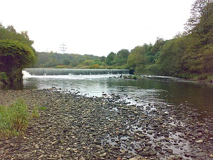 The weir to the west of the town at Ladyshore, built to supply Lever Bank Bleach Works with water. It collapsed in June 2012. Irwell weir.jpg