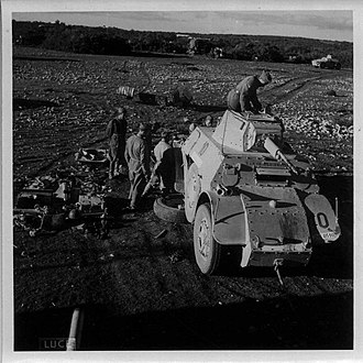 Battle of Keren - Italians repairing armoured vehicle in East Africa, 1941
