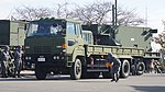 JASDF Missile Transporter(HINO Super Dolphin, 49-0167) left front view at Aibano Sub Base November 28, 2015.jpg