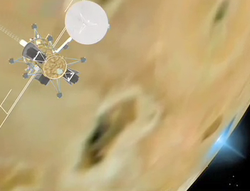 A frame from a computer animation of a spacecraft at a high altitude above a planetary body. Several dark regions are visible on the body. A bright blue cloud is visible along a portion of the horizon.