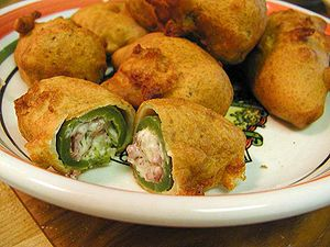 Deep-fried andouille stuffed jalapenos based o...