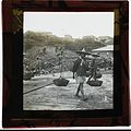 Japanese(?) man carrying masonry stone, early 1900s (2464881519).jpg