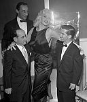 Jayne Mansfield with jockeys in 1957.jpg