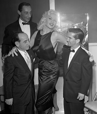 Bill Shoemaker - Jayne Mansfield with jockeys Johnny Longden, Eddie Arcaro and Willie Shoemaker (left to right) in 1957