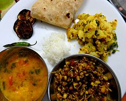 Jeera Aloo served with sprouts and dal.