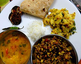 Jeera aloo - Image: Jeera aloo served with sprouts and dal