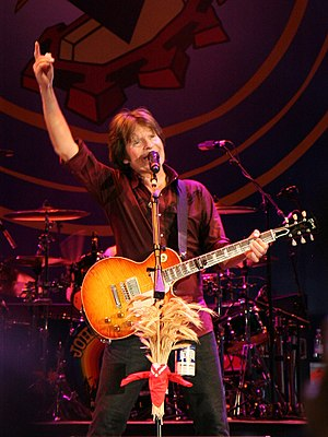 American rock musician John Fogerty, performin...