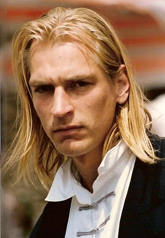 Julian Sands - Julian Sands at the 1990 Cannes Film Festival. He had grown his hair long for the character of Franz Liszt in Impromptu.