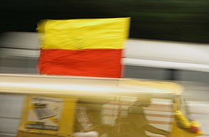 Karnataka Rajyotsava - Auto rickshaws and other vehicles are decorated with yellow and red themes signifying the Kannada flag