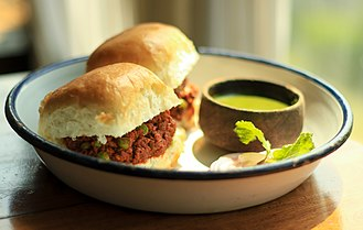 Ground meat - Keema curry on a bun (pau), a popular Mumbai street food.