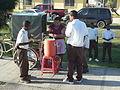 Kids buying orange juice in a bag before school in Belize City.jpg