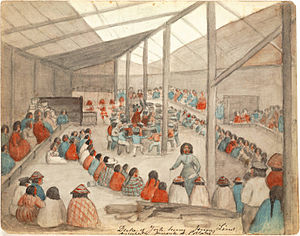 Gift economy -  Watercolor by James G. Swan depicting the Klallam people of chief Chetzemoka at Port Townsend, with one of Chetzemoka's wives distributing potlatch.