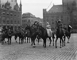 Battle of Courtrai (1918) - Liberation of Bruges - King Albert I of the Belgians with his wife, Queen Elisabeth enter Bruges on 25 October 1918 alongside Admiral Roger Keyes (far left) and the 1st Earl of Athlone (far right)