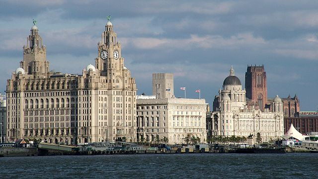 Liverpool Pier Head, with the Royal Liver Building, Cunard Building and Port of Liverpool Building, as well as the Anglican cathedral in the background. Photo by Chowells.
