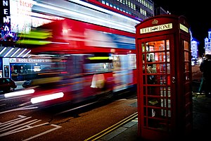 Motion blur - An example of motion blur showing a London bus passing a telephone box in London