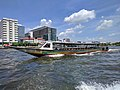 Long motorboat on the Chao Phraya River in Bangkok.jpg