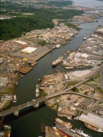Duwamish River - The lower Duwamish Waterway and the First Avenue South Bridge (State Route 99), looking north.  Slips 1, 2, and 3 can be seen on the eastern bank.  Kellogg Island is the crescent-shaped island in the upper right portion. Terminal 115 is located in the central portion
