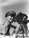 Lt. Joe J. Steinmetz with Speed Graphic camera at NAS Pensacola (9025558200).jpg