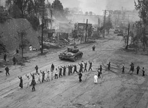 Second Battle of Seoul - American M26 Pershing tanks in downtown Seoul during the Second Battle of Seoul. In the foreground, United Nations troops round up North Korean prisoners-of-war.