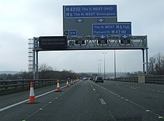 A toll gantry on M6 in the UK.