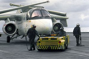 MD-3A tractor tows VS-28 S-3A on USS Forrestal (CV-59) 1988.JPEG