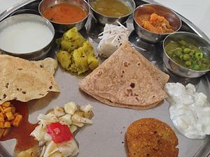 Maharashtrian cuisine - A Maharashtrian vegetarian meal with a variety of items