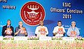 Mallikarjun Kharge releasing 'ESI Samachar' at the inauguration of the ESIC Officers Conclave-2011, in New Delhi on July 16, 2011. The Secretary, Labour and Employment, Shri Prabhat C. Chaturvedi is also seen.jpg