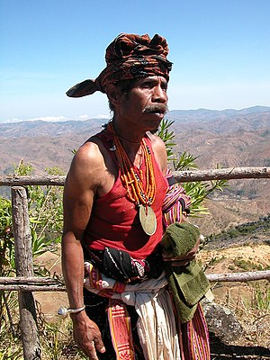 An East Timorese man in traditional attire, in...