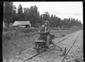 Man on a jigger near the railway camp on the approach to the Mataroa Tunnel. ATLIB 276059.png